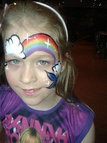 Miss Sparkles rainbow face paint